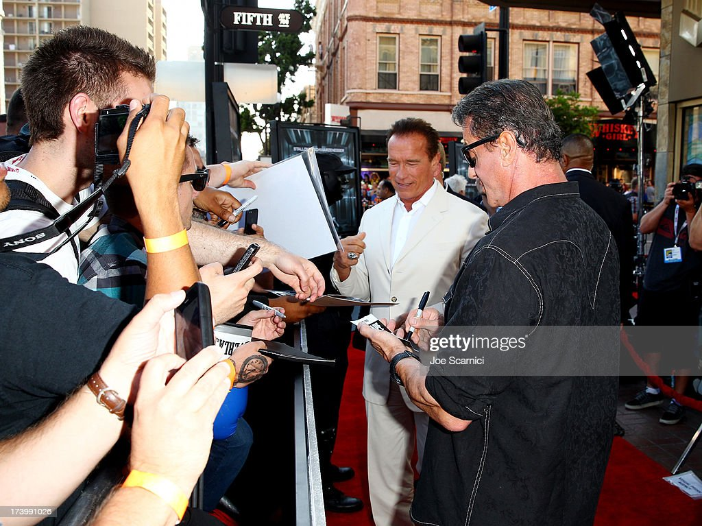 Actors Sylvester Stallone (R) and Arnold Schwarzenegger attend the 'Escape Plan' screening and red carpet during Comic-Con International 2013 at Reading Cinemas Gaslamp on July 18, 2013 in San Diego, California.