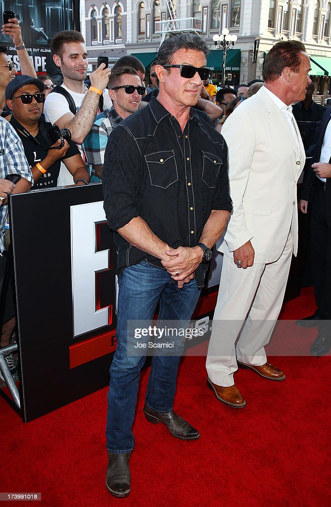 Actors Sylvester Stallone (L) and Arnold Schwarzenegger attends the 'Escape Plan' screening and red carpet during Comic-Con International 2013 at Reading Cinemas Gaslamp on July 18, 2013 in San Diego, California.