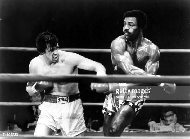 Actors Sylvester Stallone and Carl Weathers perform boxing scene in movie 'Rocky' directed by John G Avildsen 'Rocky' won 3 Academy Awards