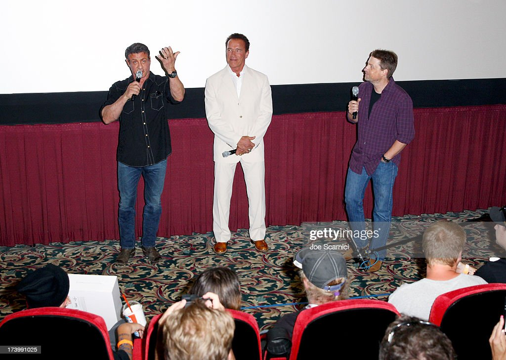 Actors Sylvester Stallone, Arnold Schwarzenegger, and director Mikael Håfström attend the 'Escape Plan' screening and red carpet during Comic-Con International 2013 at Reading Cinemas Gaslamp on July 18, 2013 in San Diego, California.