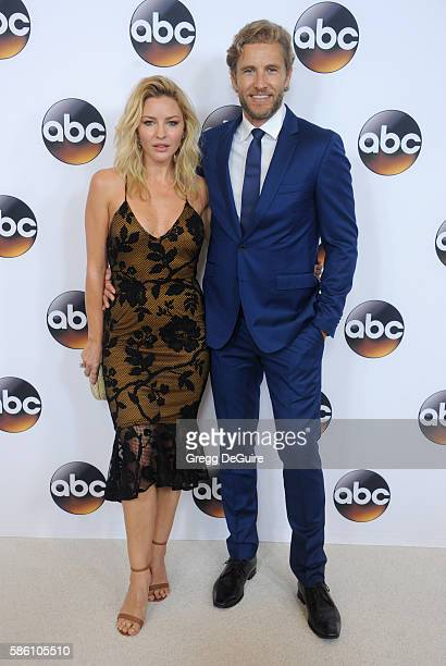 Actors Tabrett Bethell and Brett Tucker arrive at the Disney ABC Television Group TCA Summer Press Tour at the Beverly Hilton Hotel on August 4 2016...