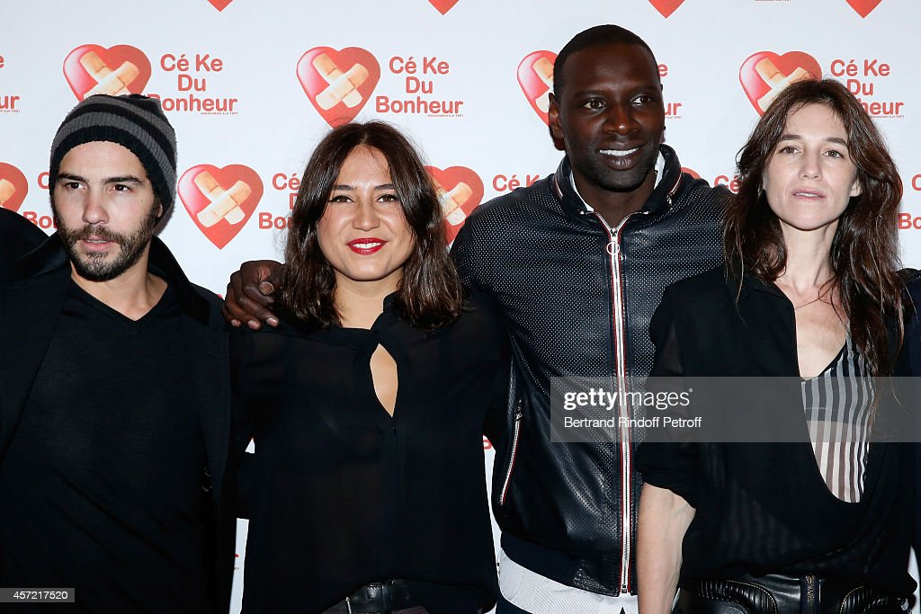 Actors Tahar Rahim, Izia Higelin, Omar Sy and Charlotte Gainsbourg attend the Samba Premiere to Benefit 'CekeDuBonheur' which celebrates its 10th anniversary. Held at Cinema Gaumont Champs Elysees on October 14, 2014 in Paris, France.