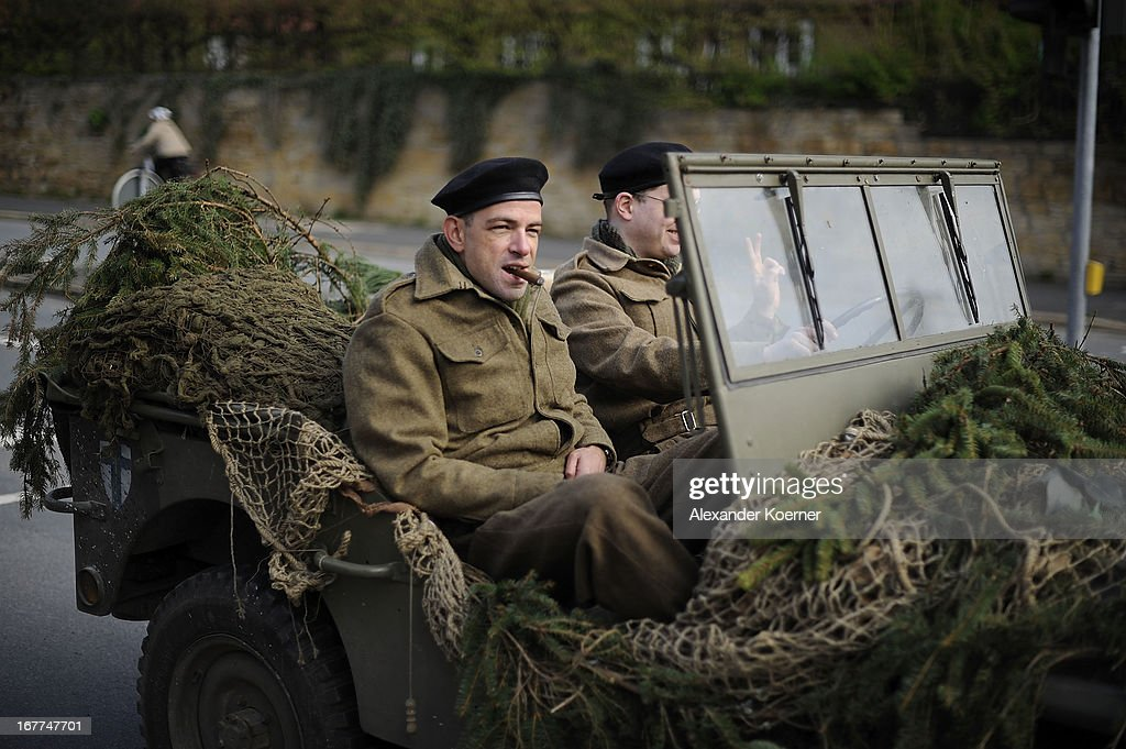 Actors take part in the film 'The Monuments Men' on set on April 29, 2013 in Goslar, Germany. Actor and director George Clooney uses several locations for his film in the state of Lower Saxony and around Germany.