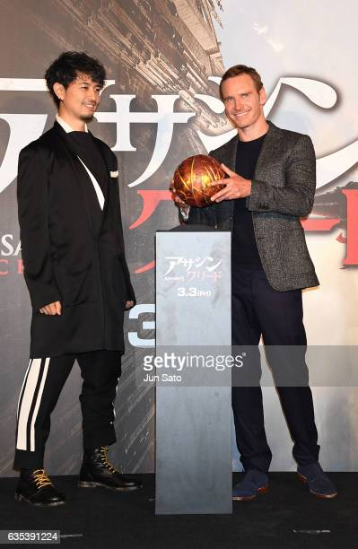 Actors Takumi Saito and Michael Fassbender attend the stage greeting event for 'Assassin's Creed' at Roppongi Hills on February 15 2017 in Tokyo Japan