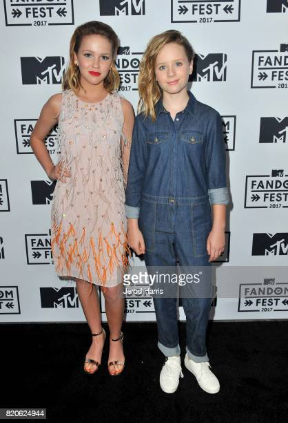 Actors Talitha Bateman and Lulu Wilson attend MTV Fandom Fest at PETCO Park on July 21 2017 in San Diego California