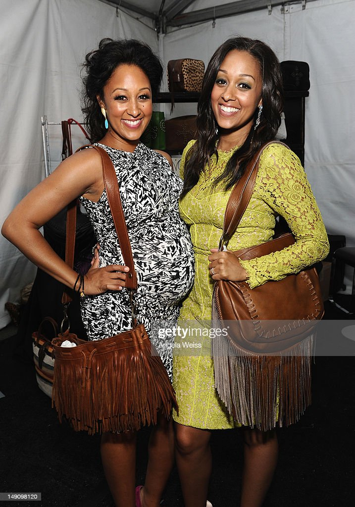 Actors <a gi-track='captionPersonalityLinkClicked' href=/galleries/search?phrase=Tamera+Mowry&family=editorial&specificpeople=798679 ng-click='$event.stopPropagation()'>Tamera Mowry</a> and <a gi-track='captionPersonalityLinkClicked' href=/galleries/search?phrase=Tia+Mowry&family=editorial&specificpeople=631098 ng-click='$event.stopPropagation()'>Tia Mowry</a> attend day 2 of Backstage Creations Celebrity Retreat at Teen Choice 2012 at Gibson Amphitheatre on July 22, 2012 in Universal City, California.