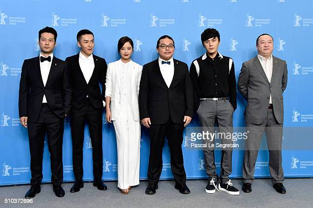 Actors Tan Kai Wu Lipeng Xin Zhi Lei director Yang Chao actor Qin Hao and producer Wang Yu attend the 'Crosscurrent' photo call during the 66th...