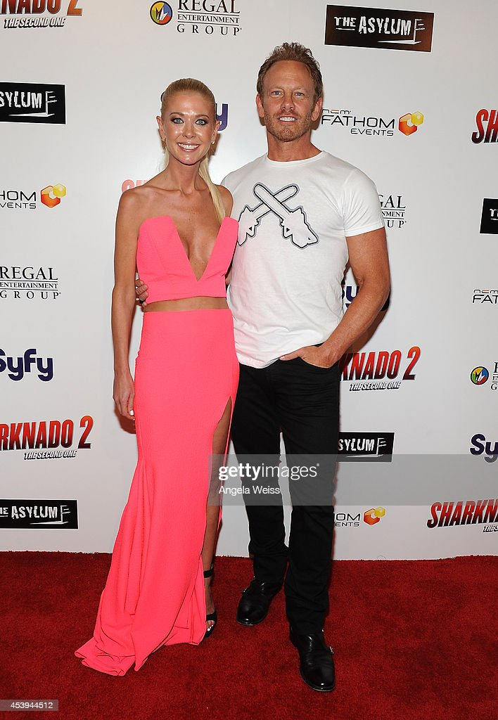 Actors <a gi-track='captionPersonalityLinkClicked' href=/galleries/search?phrase=Tara+Reid&family=editorial&specificpeople=202160 ng-click='$event.stopPropagation()'>Tara Reid</a> and <a gi-track='captionPersonalityLinkClicked' href=/galleries/search?phrase=Ian+Ziering&family=editorial&specificpeople=622264 ng-click='$event.stopPropagation()'>Ian Ziering</a> attend the premiere of The Asylum & Fathom Events' 'Sharknado 2: The Second One' at Regal Cinemas L.A. Live on August 21, 2014 in Los Angeles, California.