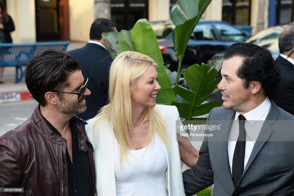 Actors Tara Reid (C) and John Leguizamo (R) attend the Premiere of Netflix's 'Bloodline' at Westwood Village Theatre on May 24, 2016 in Westwood, California.