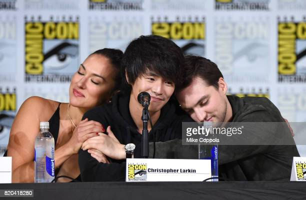 Actors Tasya Teles Christopher Larkin and Richard Harmon share a moment onstage at ComicCon International 2017 'The 100' panel at San Diego...