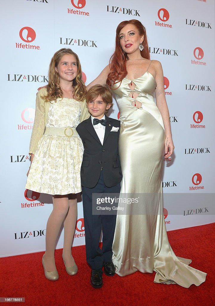 Actors Taylor Ann Thompson, Trevor Thompson, and Lindsay Lohan attend a private dinner for the Lifetime premier of 'Liz & Dick' at Beverly Hills Hotel on November 20, 2012 in Beverly Hills, California.