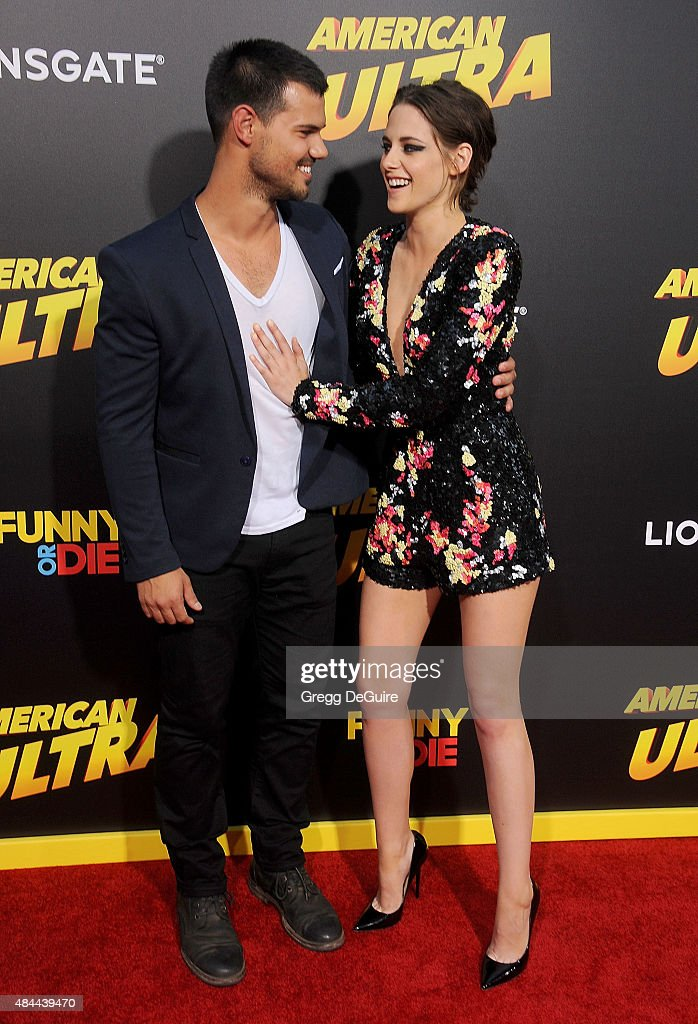 Actors <a gi-track='captionPersonalityLinkClicked' href=/galleries/search?phrase=Taylor+Lautner&family=editorial&specificpeople=228959 ng-click='$event.stopPropagation()'>Taylor Lautner</a> and <a gi-track='captionPersonalityLinkClicked' href=/galleries/search?phrase=Kristen+Stewart&family=editorial&specificpeople=2166264 ng-click='$event.stopPropagation()'>Kristen Stewart</a> arrive at the premiere of Lionsgate's 'American Ultra' at Ace Theater Downtown LA on August 18, 2015 in Los Angeles, California.