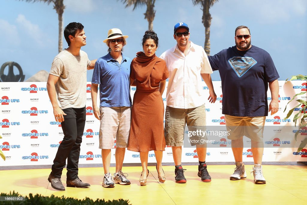 Actors Taylor Lautner, David Spade, Salma Hayek, Adam Sandler and Kevin James attend the 'Grown Ups 2' photocall during The 5th Annual Summer Of Sony on April 18, 2013 in Cancun, Mexico.