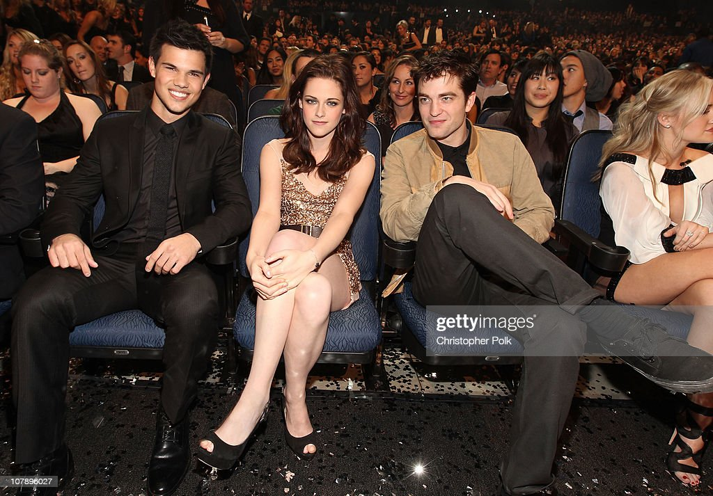 Actors Taylor Lautner, Kristen Stewart and Robert Pattinson attend the 2011 People's Choice Awards at Nokia Theatre L.A. Live on January 5, 2011 in Los Angeles, California.