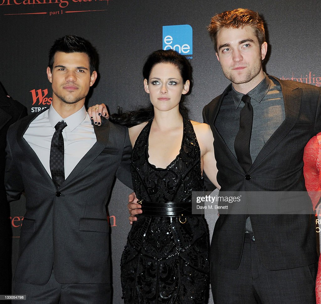Actors <a gi-track='captionPersonalityLinkClicked' href=/galleries/search?phrase=Taylor+Lautner&family=editorial&specificpeople=228959 ng-click='$event.stopPropagation()'>Taylor Lautner</a>, <a gi-track='captionPersonalityLinkClicked' href=/galleries/search?phrase=Kristen+Stewart&family=editorial&specificpeople=2166264 ng-click='$event.stopPropagation()'>Kristen Stewart</a> and <a gi-track='captionPersonalityLinkClicked' href=/galleries/search?phrase=Robert+Pattinson&family=editorial&specificpeople=734445 ng-click='$event.stopPropagation()'>Robert Pattinson</a> attend the UK Premiere of 'The Twilight Saga: Breaking Dawn Part 1' at Westfield Stratford City on November 16, 2011 in London, England.