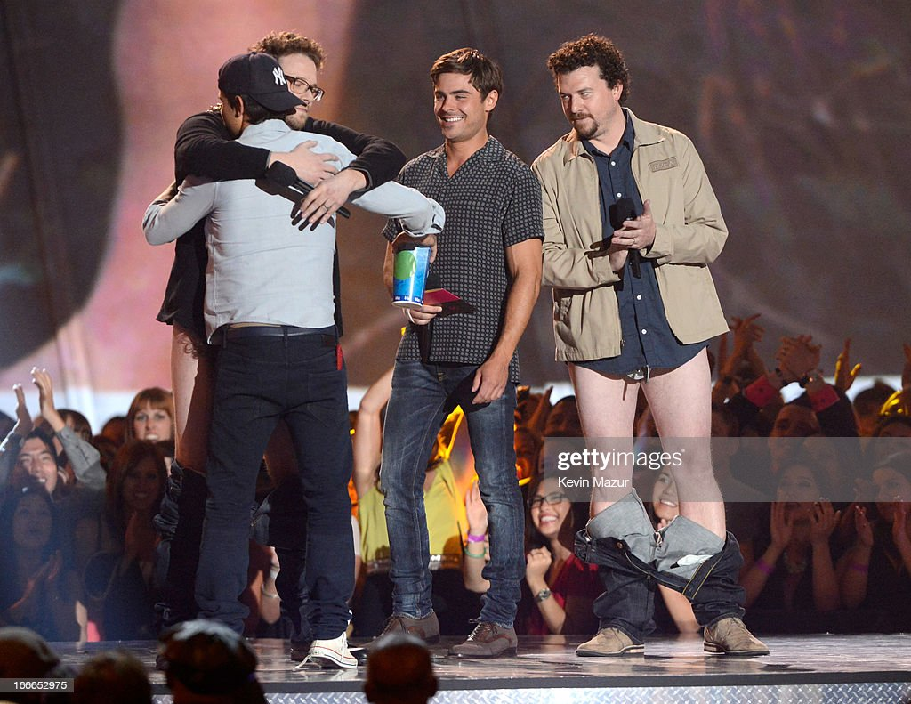 Actors Taylor Lautner, Seth Rogen, Zac Efron and Danny McBride speak onstage during the 2013 MTV Movie Awards at Sony Pictures Studios on April 14, 2013 in Culver City, California.