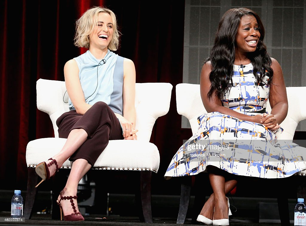 Actors Taylor Schilling and Uzo Aduba speak onstage during the 'Orange Is the New Black' panel discussion at the Netflix portion of the 2015 Summer TCA Tour at The Beverly Hilton Hotel on July 28, 2015 in Beverly Hills, California.