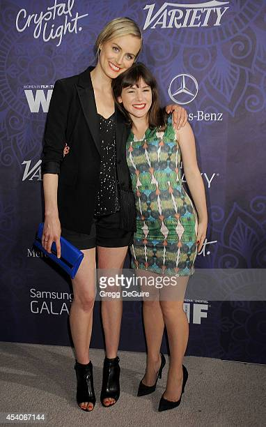 Actors Taylor Schilling and Yael Stone arrive at the Variety And Women In Film Annual PreEmmy Celebration at Gracias Madre on August 23 2014 in West...