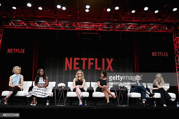 Actors Taylor Schilling Uzo Aduba Natasha Lyonne Selenis Leyva Lea DeLaria and Taryn Manning speak onstage during the 'Orange Is the New Black' panel...