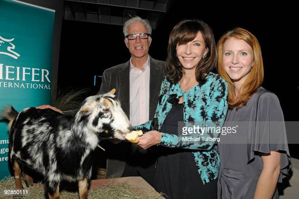 Actors Ted Danson Mary Steenburgen and Steenburgen's daughter Lilly McDowell pose with a goat at Heifer International's Los Angeles screening of the...