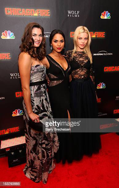 Actors Teri Reeves Monica Raymund and Lauren German attend NBC's 'Chicago Fire' premiere at the Chicago History Museum on October 2 2012 in Chicago...