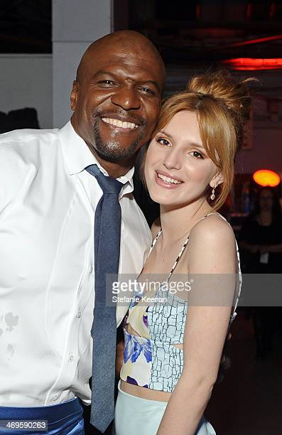 Actors Terry Crews and Bella Thorne attend Cartoon Network's fourth annual Hall of Game Awards at Barker Hangar on February 15 2014 in Santa Monica...