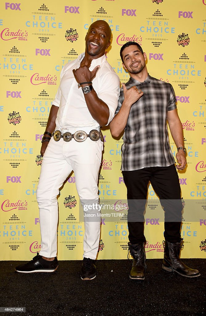 Actors Terry Crews (L) and Wilmer Valderrama pose in the press room during the Teen Choice Awards 2015 at the USC Galen Center on August 16, 2015 in Los Angeles, California.