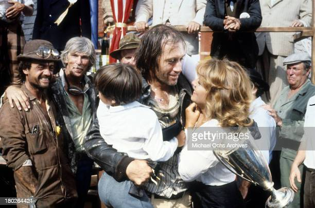 Actors Terry Kiser LQ Jones Whit Clay David Carradine and actress Brenda Vaccaro on set of the Universal Studios movie ' Fast Charlie the Moonbeam...