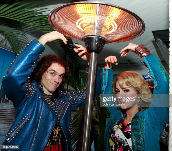 Actors Tessa Alves and Justin Matthew Sargent of Rock of Ages attend the Norwegian Warming Station launch in Times Square on January 28 2013 in New...