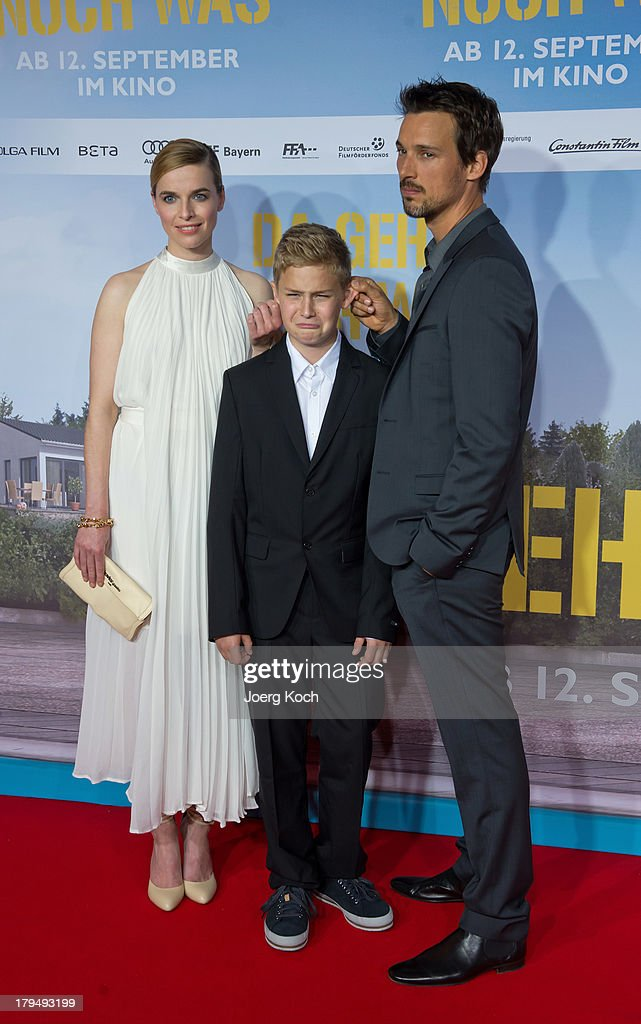 Actors Thekla Reuten, Marius Haas (M) and Florian David Fitz pose at the 'Da geht noch was' Germany premiere at Mathaeser on September 4, 2013 in Munich, Germany.