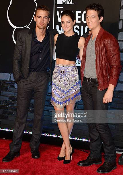 Actors Theo James Shailene Woodley and Miles Teller attend the 2013 MTV Video Music Awards at the Barclays Center on August 25 2013 in the Brooklyn...