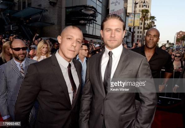 Actors Theo Rossi and Charlie Hunnam attend the season 6 premiere of FX's 'Sons Of Anarchy' at Dolby Theatre on September 7 2013 in Hollywood...