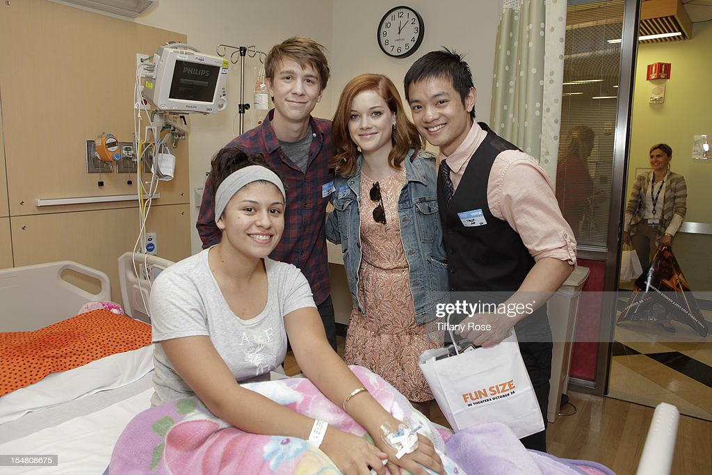 Actors Thomas Mann Jane Levy and Osric Chau pose with a patient at 'Fun Size' Special Screening At Children's Hospital Los Angeles at Childrens...