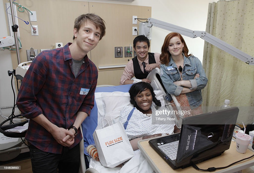 Actors Thomas Mann Osric Chau and Jane Levy pose with a patient at 'Fun Size' Special Screening At Children's Hospital Los Angeles at Childrens...