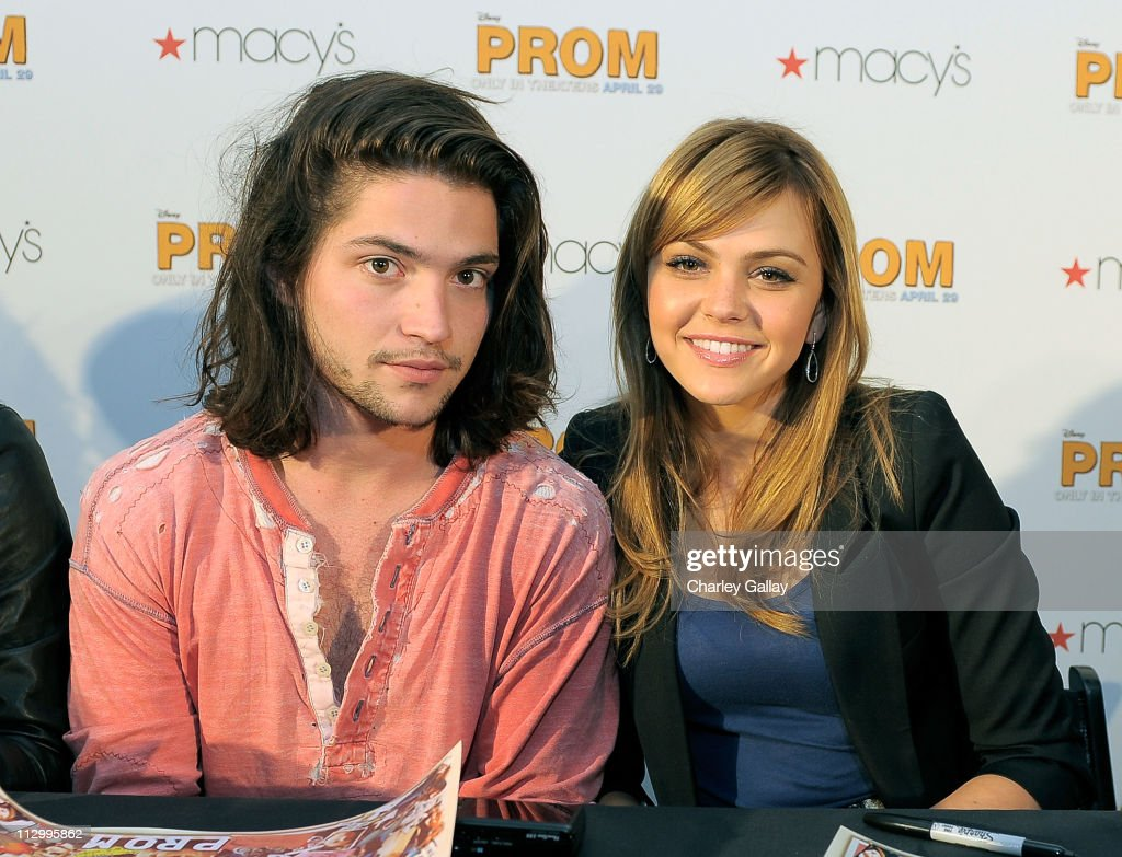 Actors Thomas McDonell and Aimee Teegarden members of the talented emerging ensemble cast of Walt Disney Pictures' 'Prom' meet fans and sign...