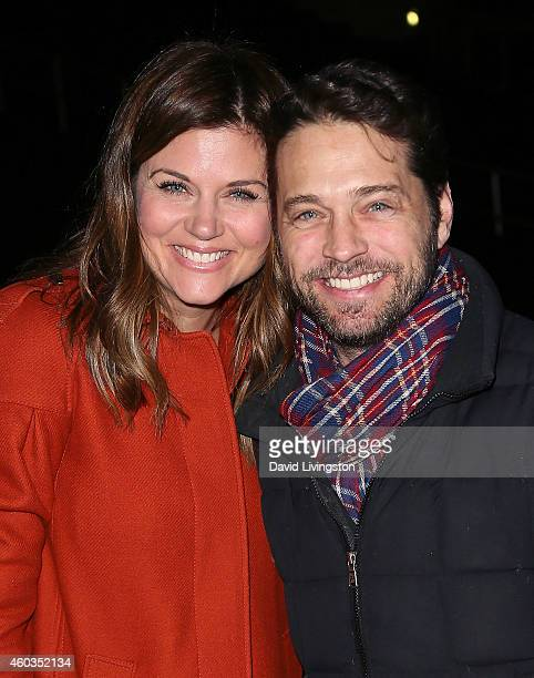 Actors Tiffani Thiessen and Jason Priestley attend Disney On Ice presents Let's Celebrate at Staples Center on December 11 2014 in Los Angeles...