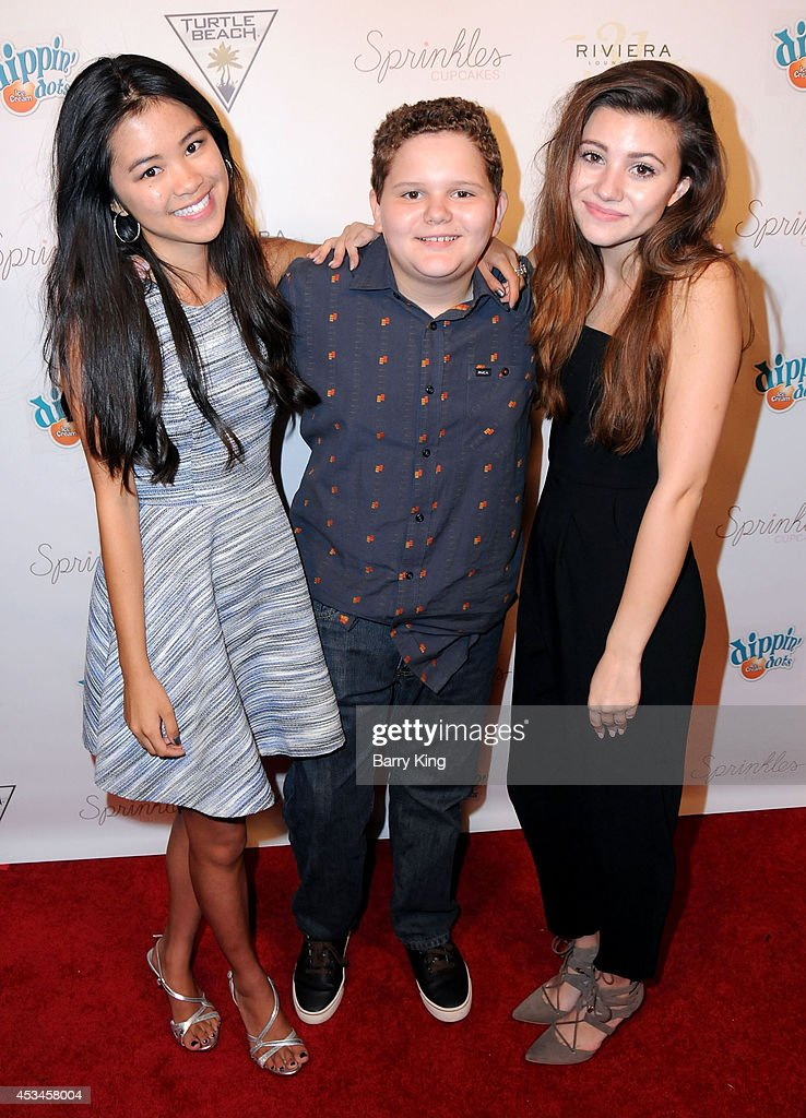 Actors TIffany Espensen, Cade Sutton and Olivia Stuck arrive at Blake Michael's 18th Birthday on Riviera 31 on August 9, 2014 in Beverly Hills, California.
