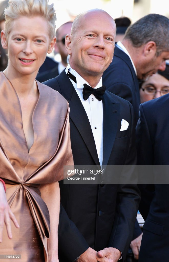 Actors <a gi-track='captionPersonalityLinkClicked' href=/galleries/search?phrase=Tilda+Swinton&family=editorial&specificpeople=202991 ng-click='$event.stopPropagation()'>Tilda Swinton</a> and <a gi-track='captionPersonalityLinkClicked' href=/galleries/search?phrase=Bruce+Willis&family=editorial&specificpeople=202185 ng-click='$event.stopPropagation()'>Bruce Willis</a> attend the Opening Ceremony and 'Moonrise Kingdom' Premiere during the 65th Annual Cannes Film Festival at the Palais des Festivals on May 16, 2012 in Cannes, France.