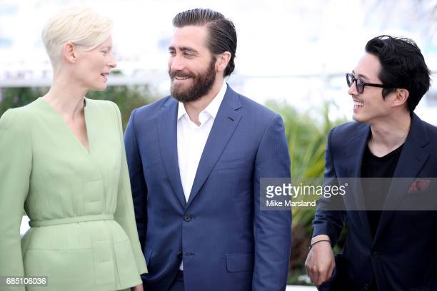 Actors Tilda Swinton Jake Gyllenhaal and Steven Yeun attend the 'Okja' photocall during the 70th annual Cannes Film Festival at Palais des Festivals...