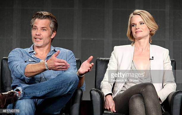Actors Timothy Olyphant and Joelle Carter speak onstage during the 'Justified' panel discussion at the FX Networks portion of the Television Critics...