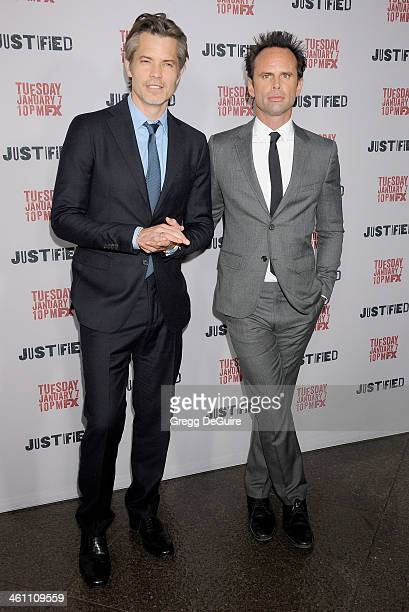 Actors Timothy Olyphant and Walton Goggins arrive at the Los Angeles premiere of FX 'Justified' at DGA Theater on January 6 2014 in Los Angeles...