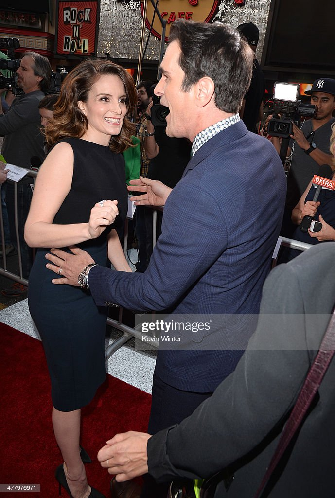 Actors <a gi-track='captionPersonalityLinkClicked' href=/galleries/search?phrase=Tina+Fey&family=editorial&specificpeople=206753 ng-click='$event.stopPropagation()'>Tina Fey</a> and <a gi-track='captionPersonalityLinkClicked' href=/galleries/search?phrase=Ty+Burrell&family=editorial&specificpeople=700077 ng-click='$event.stopPropagation()'>Ty Burrell</a> arrive for the premiere of Disney's 'Muppets Most Wanted' at the El Capitan Theatre on March 11, 2014 in Hollywood, California.