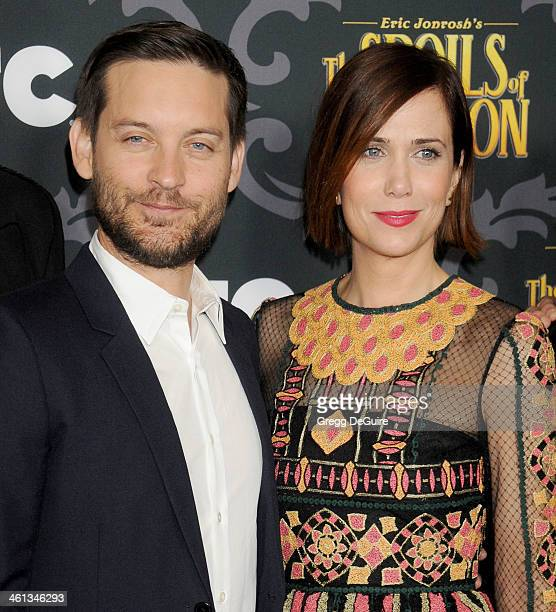 Actors Tobey Maguire and Kristen Wiig arrive at the Los Angeles premiere of 'The Spoils Of Babylon' at DGA Theater on January 7 2014 in Los Angeles...