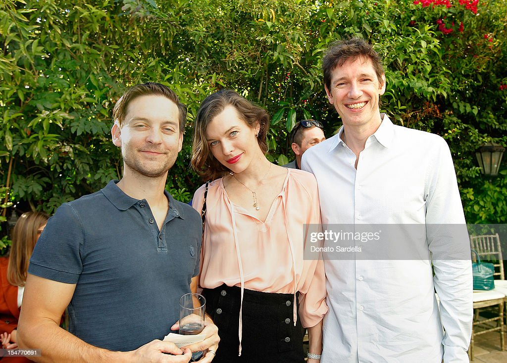 Actors Tobey Maguire, Milla Jovovich and Paul W. S. Anderson attends CFDA/Vogue Fashion Fund Event hosted by Lisa Love and Mark Holgate and sponsored by Audi, Beauty.com, American Express, and J Brand at Chateau Marmont on October 25, 2012 in Los Angeles, California.
