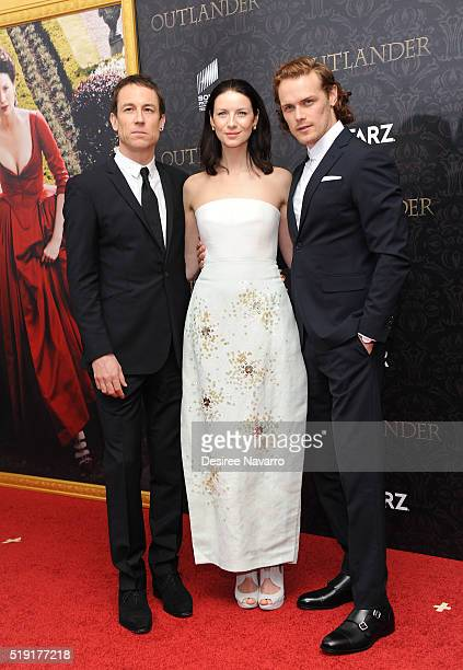 Actors Tobias Menzies Caitriona Balfe and Sam Heughan attend 'Outlander' Season Two World Premiere at American Museum of Natural History on April 4...