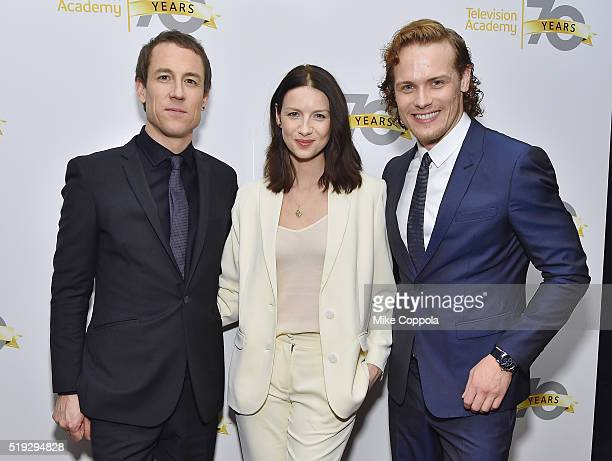 Actors Tobias Menzies Caitriona Balfe and Sam Heughan pose for a picture as the Television Academy Presents 'Outlander' Panel Discussion at NYU...
