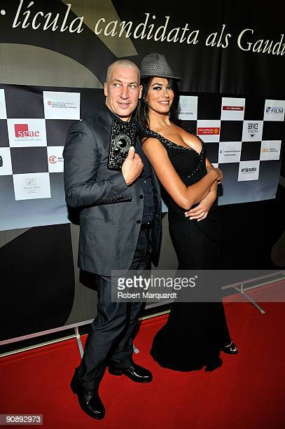 Actors Tobias Moretti and Maria Grazia Cucinotta attend the premiere of the film 'Flores Negras' at Cine Comedia on September 17 2009 in Barcelona...