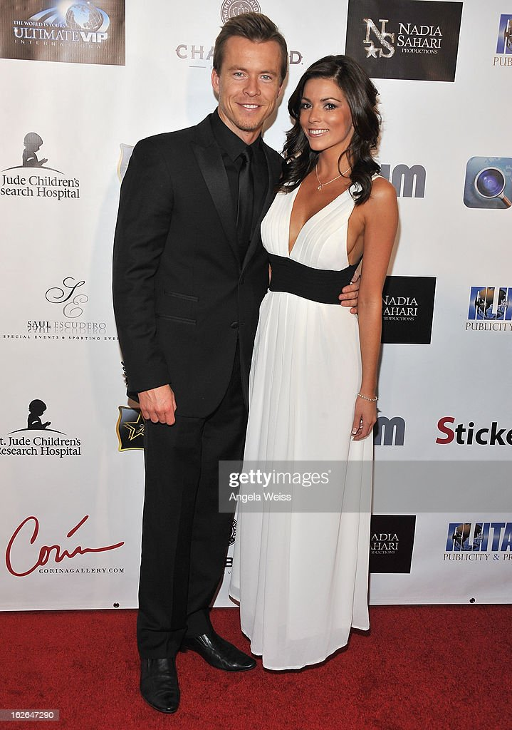 Actors Todd Lasance and Kerryn Amyes attend the Hellman & Walter's 'Salute To The Stars' Oscar after party at Andaz on February 24, 2013 in West Hollywood, California.