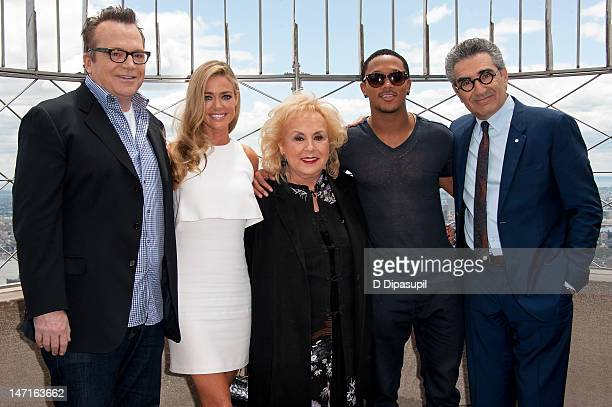 Actors Tom Arnold Denise Richards Doris Roberts Romeo Miller and Eugene Levy visit The Empire State Building on June 26 2012 in New York City
