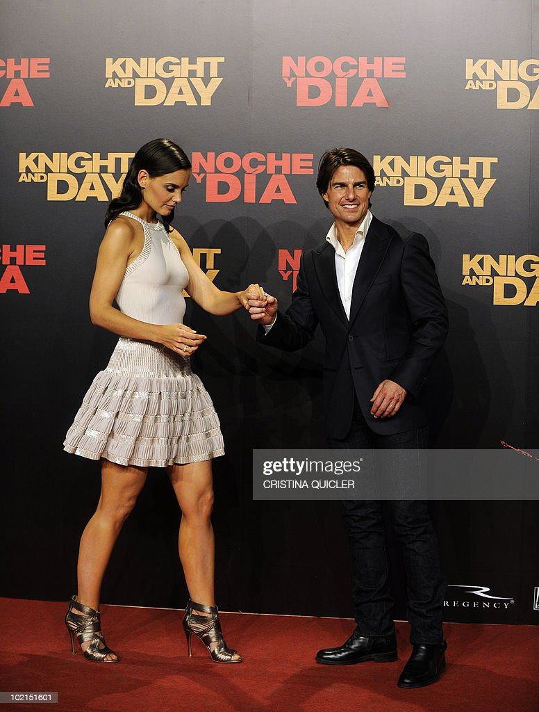 US actors Tom Cruise (R) and his wife Katie Holmes (L) arrive for the international film premiere of the film 'Knight and Day' by US director James Mangold in Sevilla on June 16, 2010. Cruise, 47, filmed key scenes of the action-comedy movie in Seville as well as in the nearby coastal city of Cadiz last year.